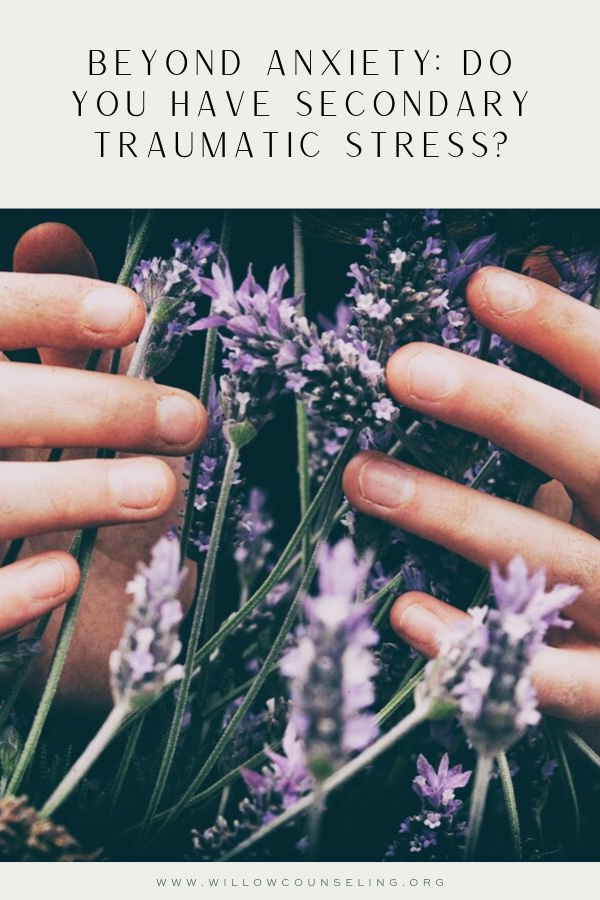 Photo of hands holding lavender flowers. Healing from secondary traumatic stress| signs of compassion fatigue | Anxiety Treatment | Nashville, TN
