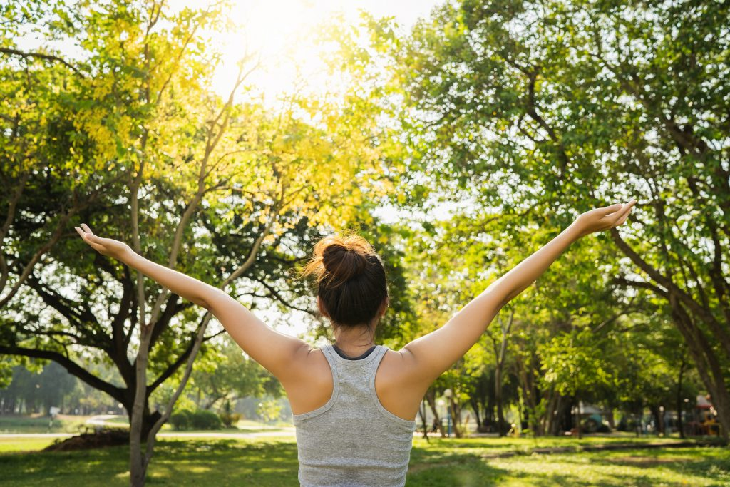 Healthy young asian woman stretching after a run. She found relief for PTSD symptoms after attending trauma therapy with an EMDR trained counselor in Nashville.